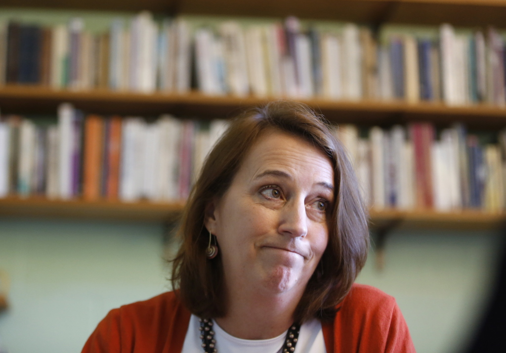 """Jane Kuenz, chairwoman of the University of Southern Maine's English department, speaks Monday about the latest layoffs. She said, """"I think people in Maine have to decide if they want a university. If you want a university, you have to put money into it."""""""