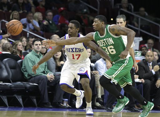 Celtics point guard Marcus Smart and 76ers point guard Casper Ware chase a loose ball in the first half Oct. 16 in Philadelphia. The Associated Press