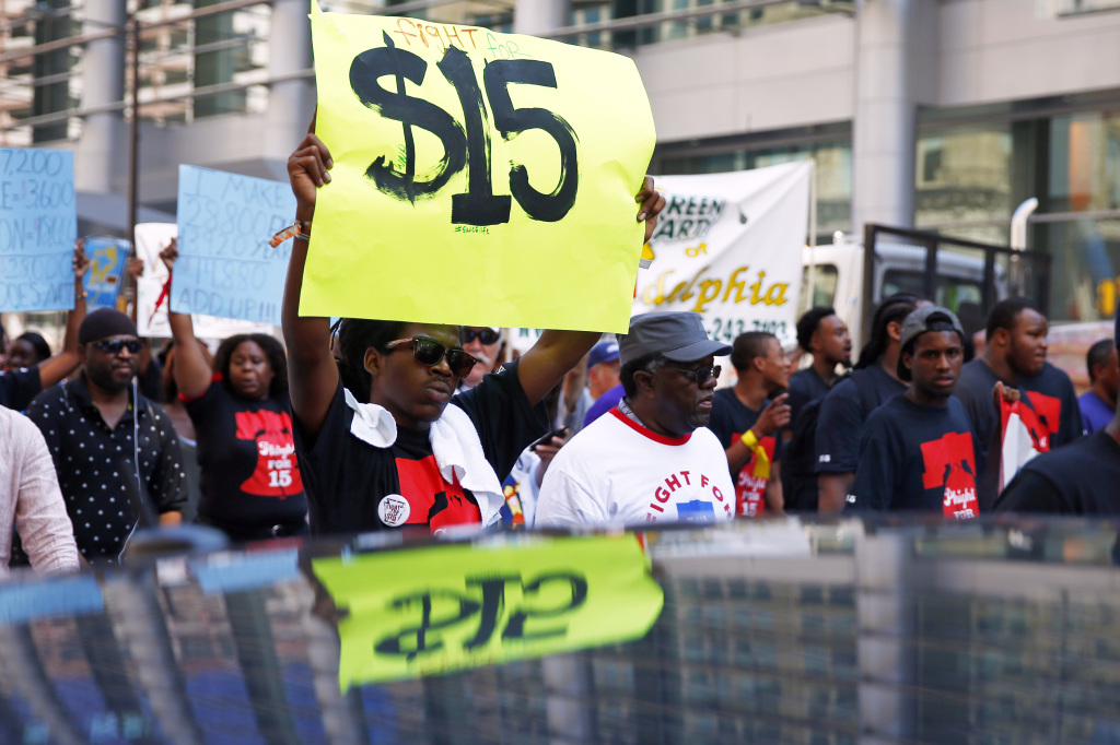 Fast-food workers seeking higher pay are battling a tough fact of life: Hiring is healthy but wages are stagnant. And no one is sure when pay increases will come.