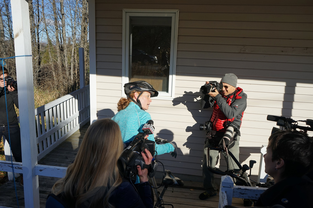 Kaci Hickox makes her way back into her house with members of the media surrounding her after a morning bike ride in Fort Kent.