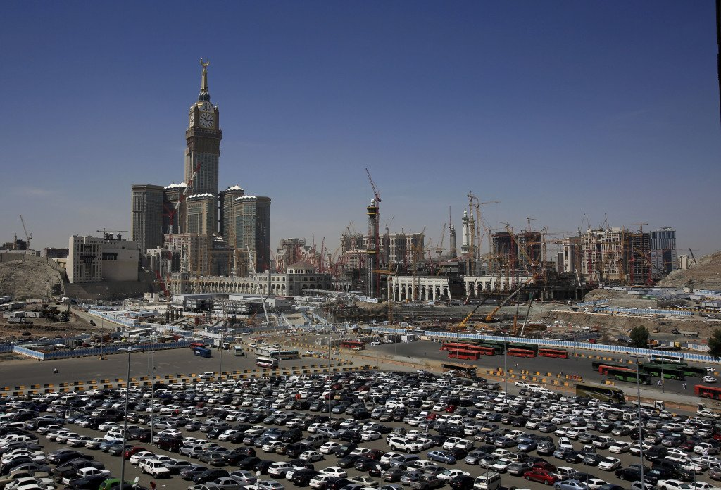 In this May 13, 2014, photo, construction cranes and scaffolding dominate the minarets and entries to the Kaaba at Mecca, Saudi Arabia. The Associated Press
