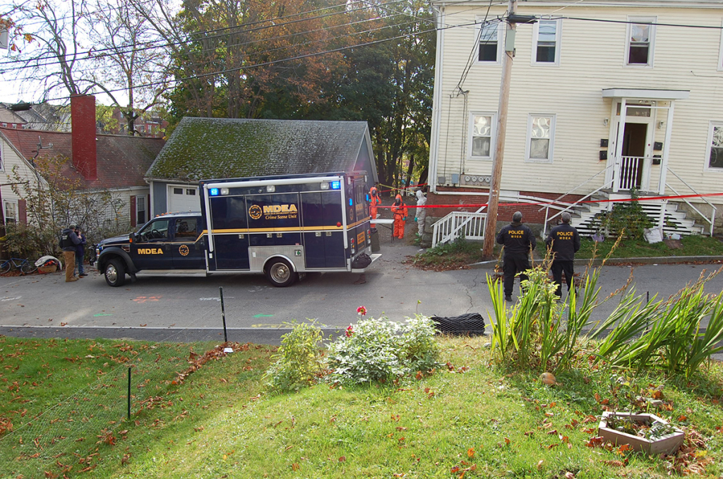 Investigators search the scene of a suspected meth lab at 50 Elm St. in Bath on Friday, October 31, 2014.