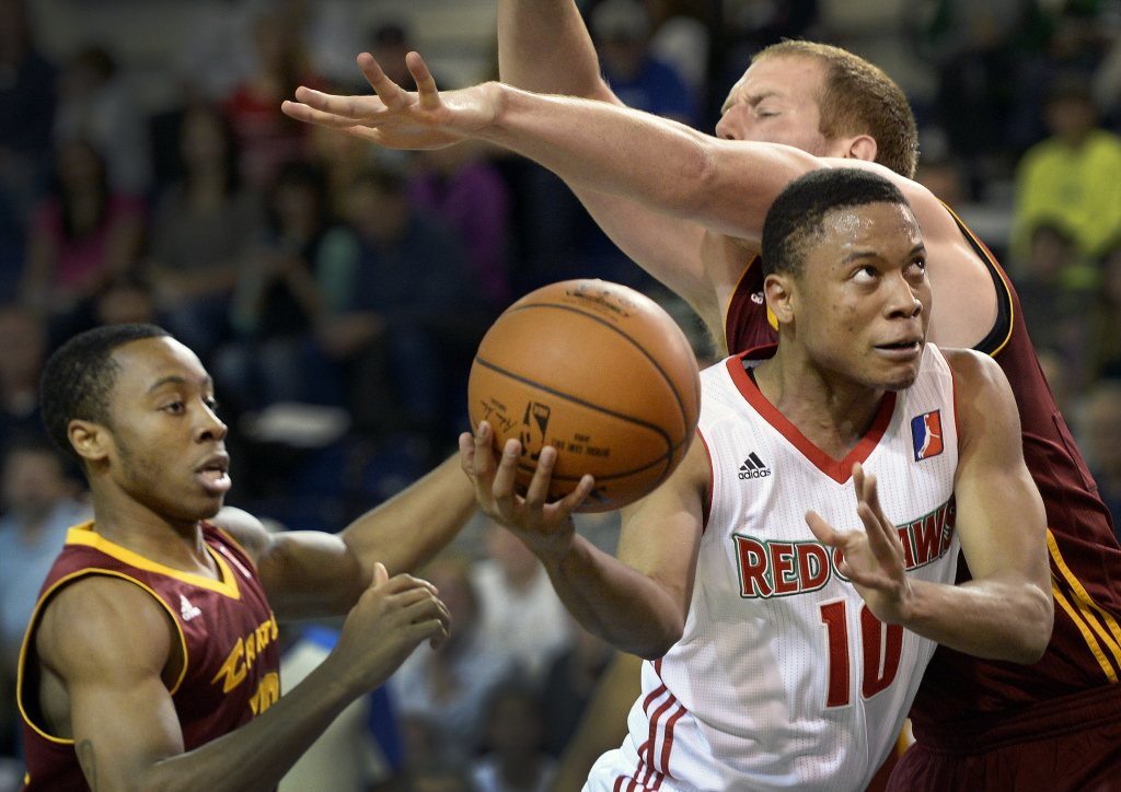 Tim Frazier of the Maine Red Claws goes between two Canton Charge defenders on his way to the basket Friday. Shawn Patrick Ouellette/Staff Photographer