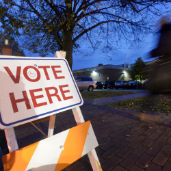 Voters make their way to the polls at the Reiche Community School in Portland in 2014. The school will hold classes on Election Day this year  because the polling location is apart from the classroom and student space.
