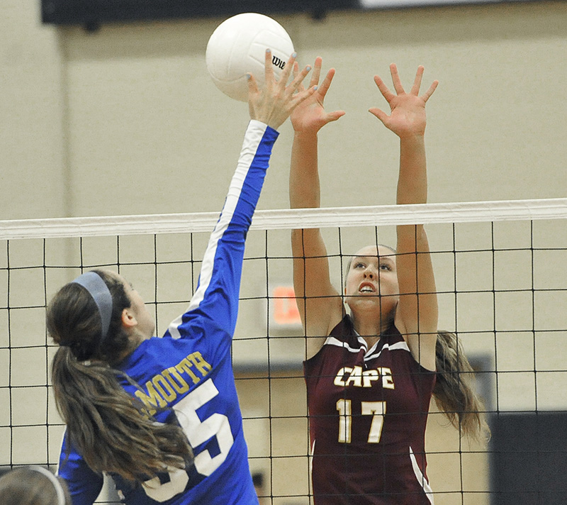 Cape's #17 Tess Haller tries to block a shot from Falmouth's #35 Allyson Hickey as Cape Elizabeth plays Falmouth for the Class A Volleyball State Championship at Biddeford HS. John Patriquin/Staff Photographer