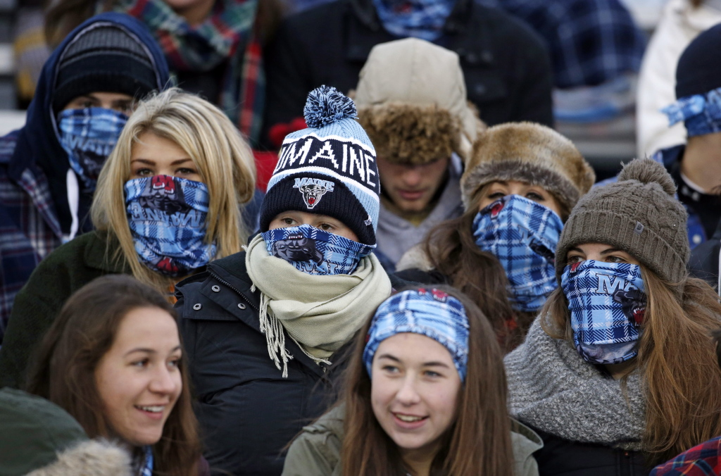 Maine fans cheer during a college football game between Maine and New Hampshire on Saturday in Orono. Organizers hoped to boost attendance by giving away bandannas in an attempt to set a Guinness world record.