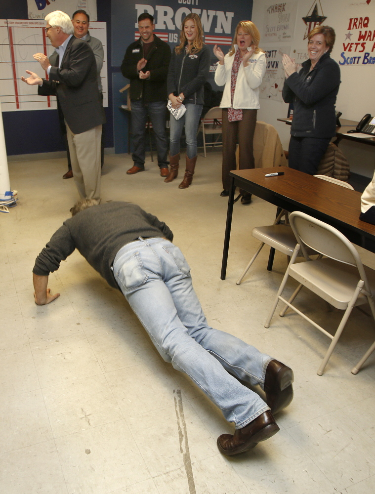 Former Massachusetts Sen. Scott Brown, now a Republican candidate for Senate in New Hampshire, rallies volunteers in Manchester by doing pushups Friday.