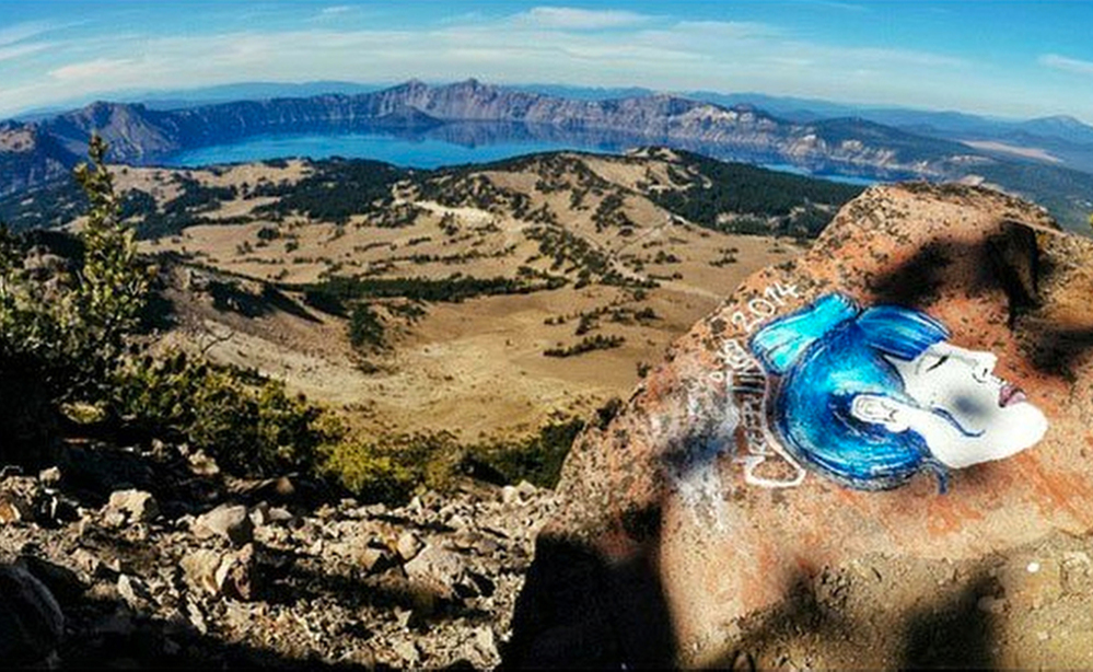 A rock painting on an overlook at Crater Lake National Park in Oregon is among several that managers have to deal with at parks across California, Colorado, Utah and Oregon.