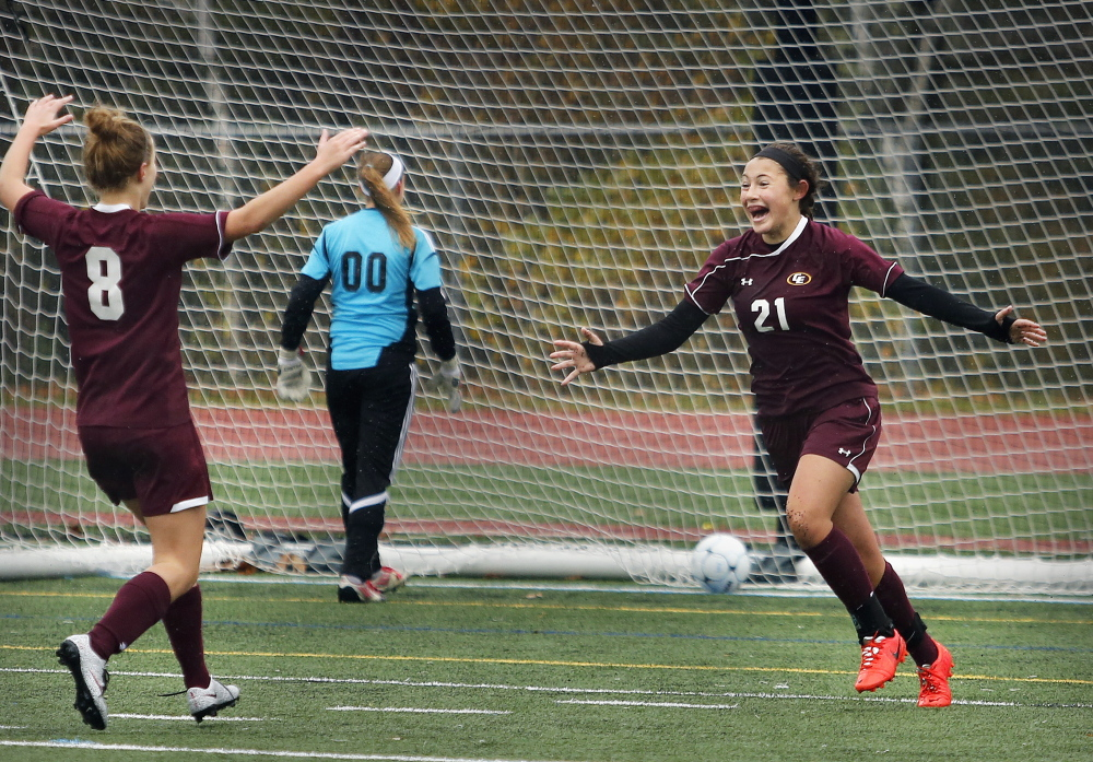 Mariah Deschino of Cape Elizabeth, right, celebrates with teammate Kate Breed after scoring in the second half as Cape Elizabeth defeated Yarmouth on Saturday 1-0 in a Western Class B semifinal.Derek Davis/Staff Photographer