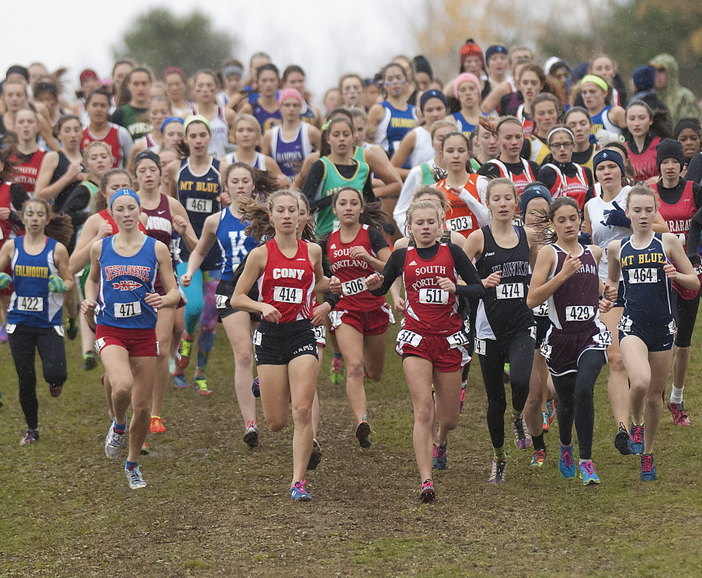 The battle for position is on at the start of the Class A girls' race Saturday at the cross country state championships. Scarborough captured the team title.
