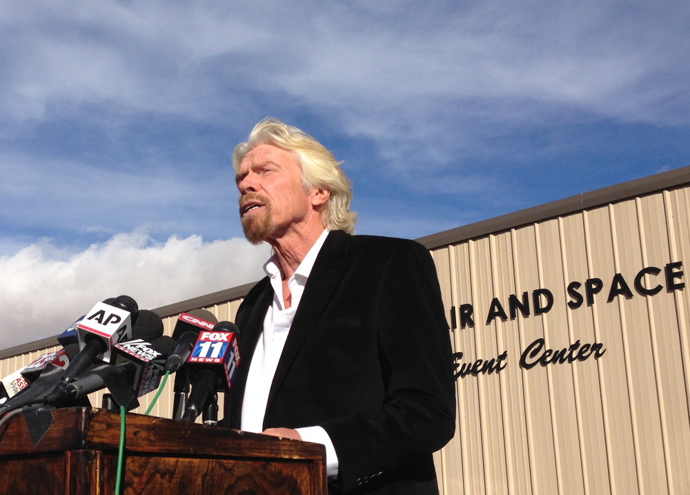 Billionaire Virgin Galactic founder Richard Branson, during a news conference in Mojave, Calif., on Saturday, salutes the bravery of test pilots, and vows to find out what caused the crash of his prototype space tourism rocket that killed one crew member and injured another. Virgin Galactic's SpaceShipTwo blew apart about 20 miles from the Mojave airfield after being released from a carrier aircraft Friday.