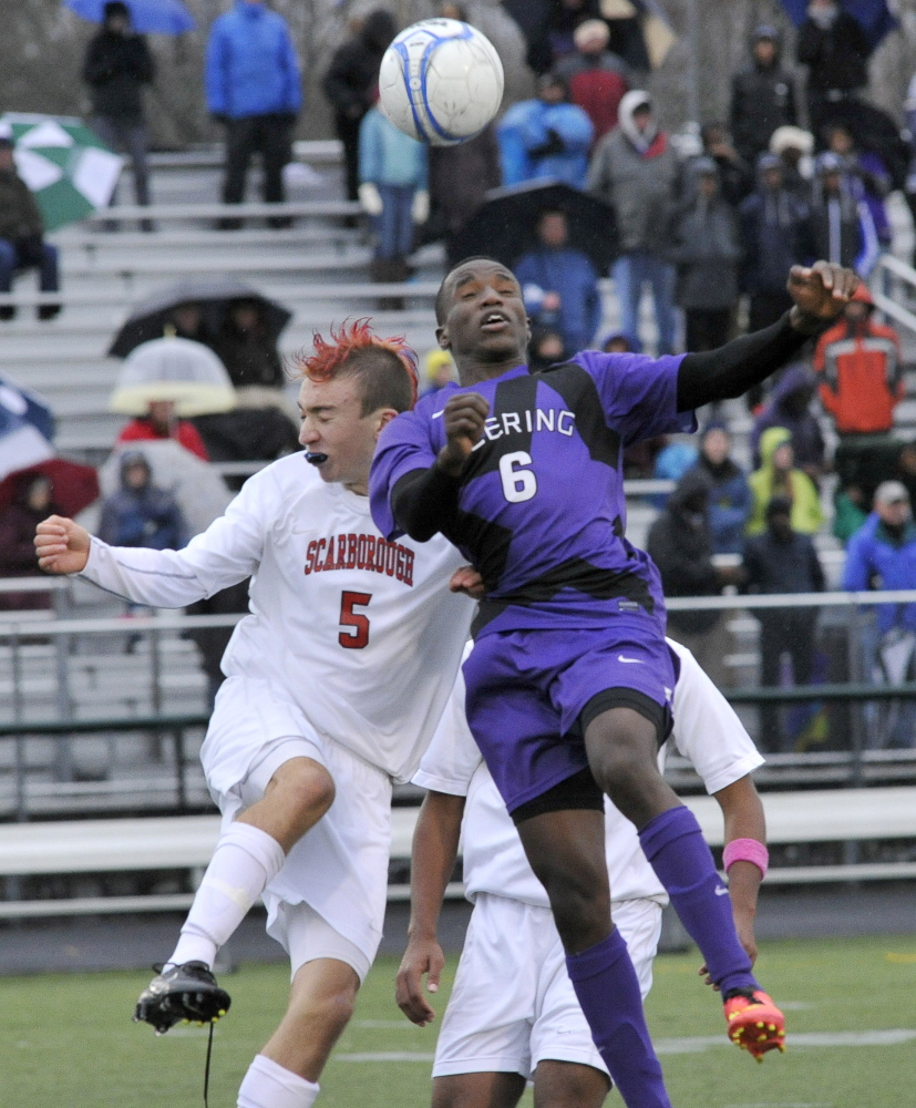 Hany Ramadan of Deering and Nick Lorello of Scarborough go for the ball Saturday during Scarborough's 3-1 victory in a Western Class A boys' soccer semifinal. John Patriquin/ Staff Photographer