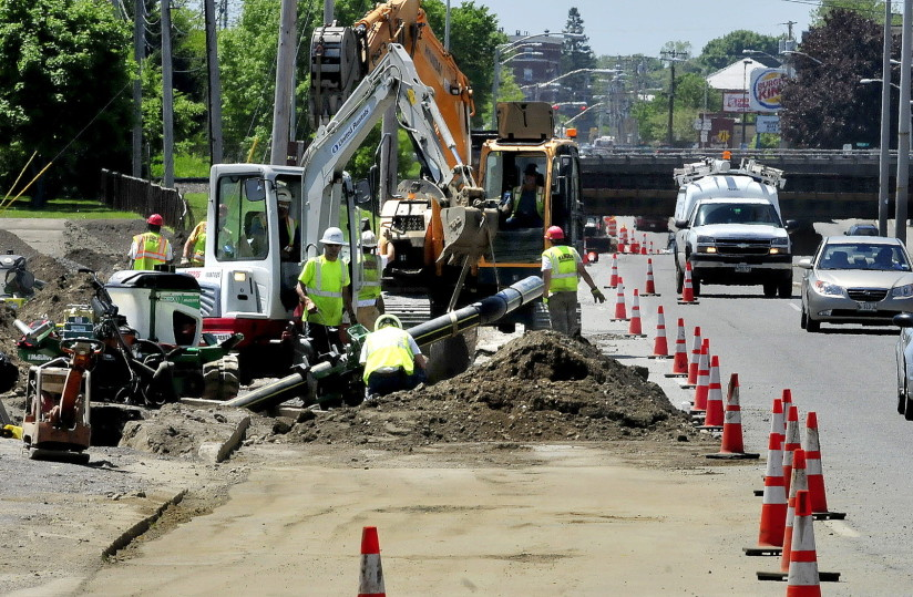 Contractors install a natural gas pipeline on College Avenue in Waterville in June. The Maine Public Utilities Commission voted last week to review three proposals to expand pipeline capacity in New England.