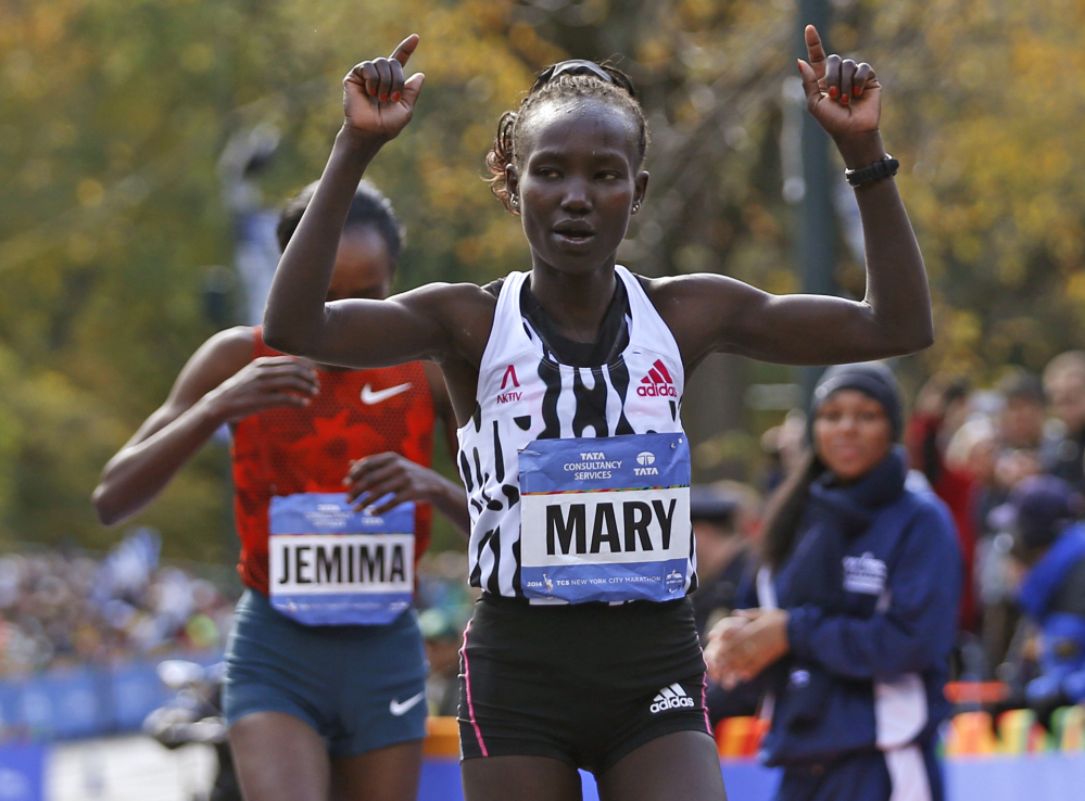 Mary Keitany celebrates as she edges out Jemima Sumgong, both of Kenya, after the pair finished first and second in the women's division of the 44th annual New York City Marathon in New York on Sunday.