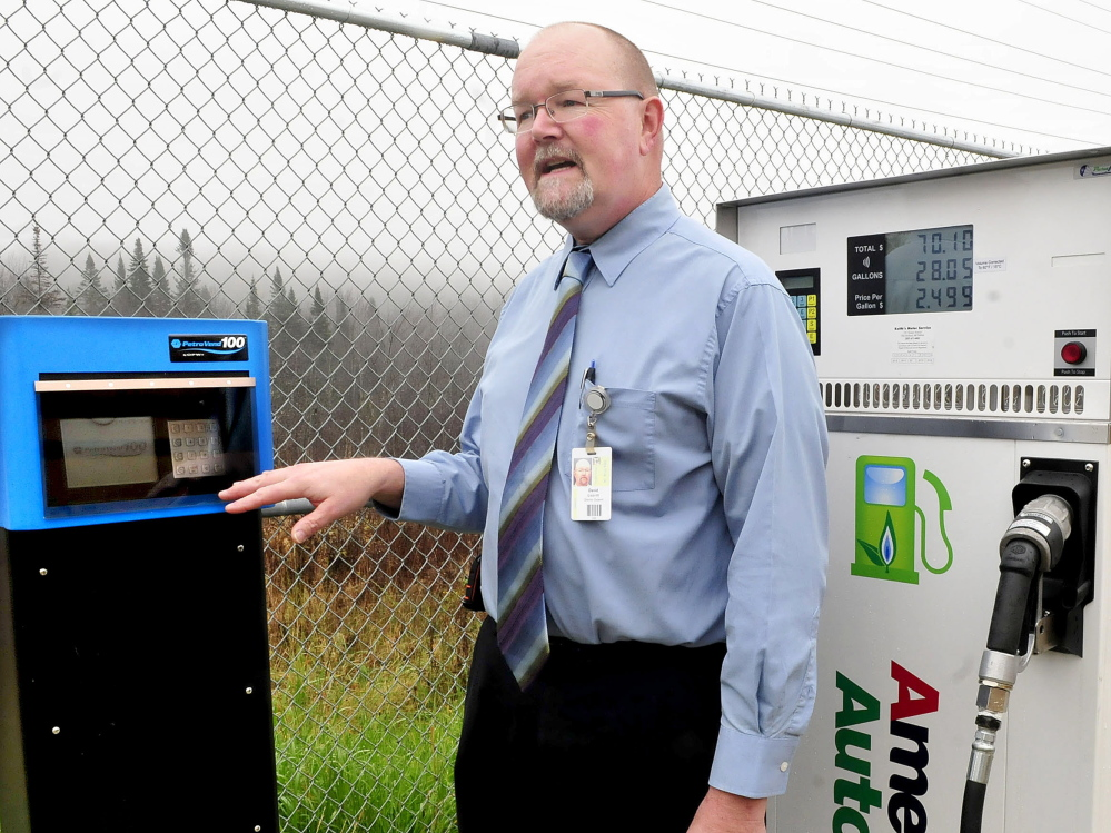 David Leavitt, director of support services for RSU 9 in Farmington, shows the meter system on a propane pump that will be used to fuel several buses at the bus garage.