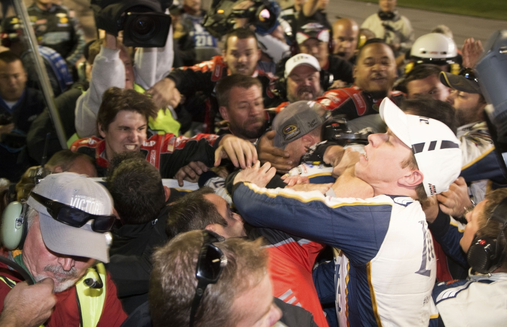 Brad Keselowski, right, is punched during a fight after the NASCAR Sprint Cup Series auto race at Texas Motor Speedway in Fort Worth, Texas, Sunday. The crews of Jeff Gordon and Keselowski fought after the race.