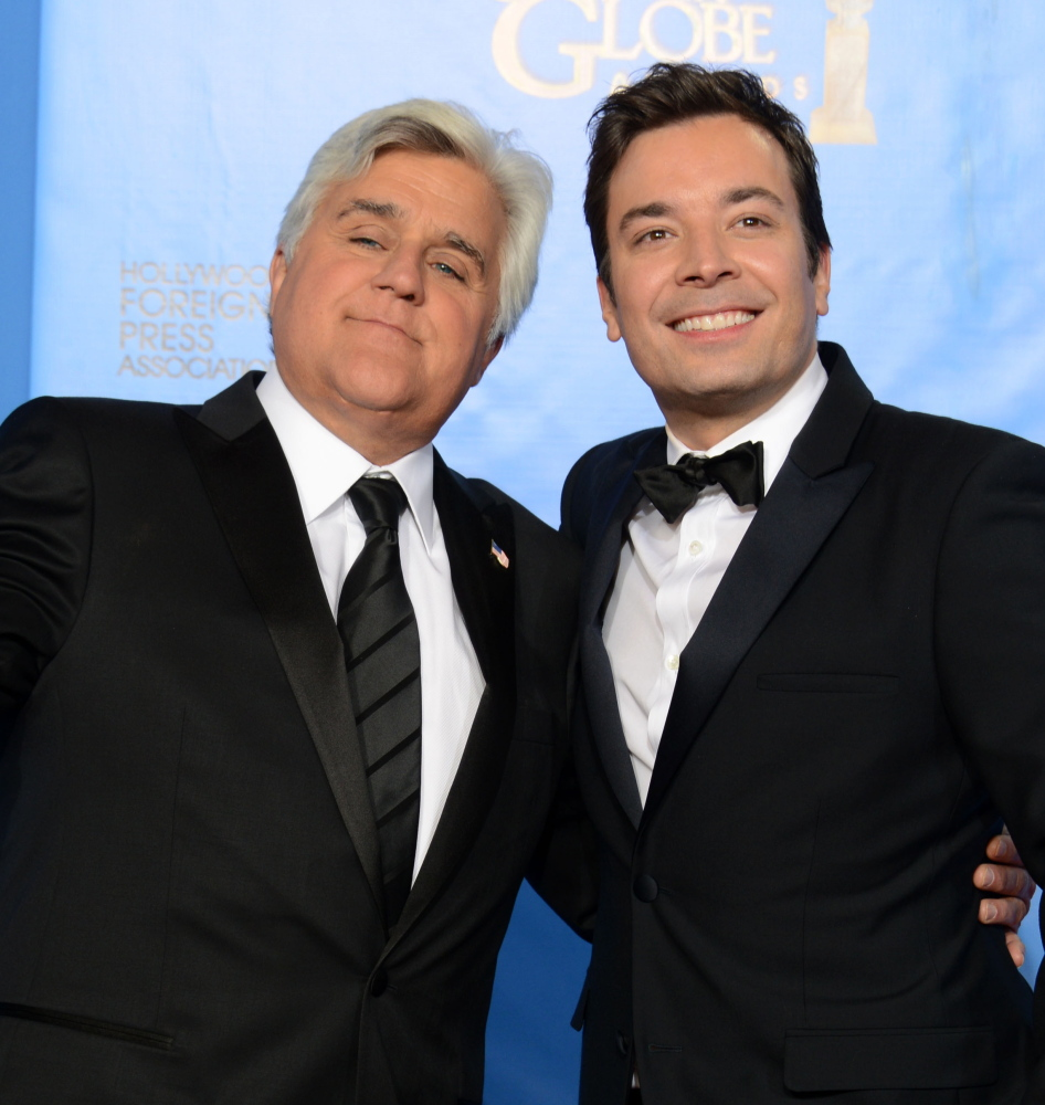"""Jay Leno, left, and Jimmy Fallon meet backstage at the 70th Annual Golden Globe Awards in Beverly Hills, Calif., in 2013. Leno will be a guest on """"Tonight"""" on Friday."""