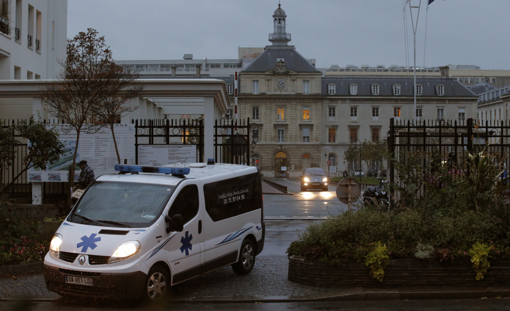 "An ambulance exits the main entrance Monday of a hospital in eastern Paris, where a UNICEF employee infected with Ebola in Sierra Leone has been admitted for treatment. France's Health Ministry said the patient was being cared for in ""high-security isolation."""