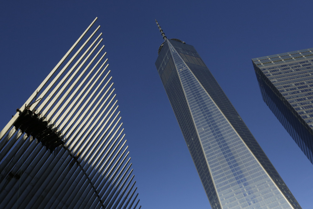 One World Trade Center stands between the transportation hub, left, and 7 World Trade Center, right, in New York. The 104-story skyscraper dominates the Manhattan skyline.