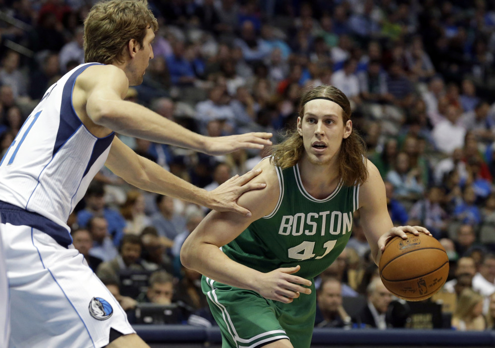 Boston Celtics center Kelly Olynyk drives against Dallas Mavericks forward Dirk Nowitzki in the first half of Monday night's game in Dallas. The Celtics trailed by 31 points in the second quarter before closing the deficit to three in the last minute of the game.