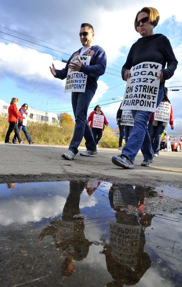 Striking workers march on the FairPoint Communications location on Davis Farm Road in Portland on Oct. 30.