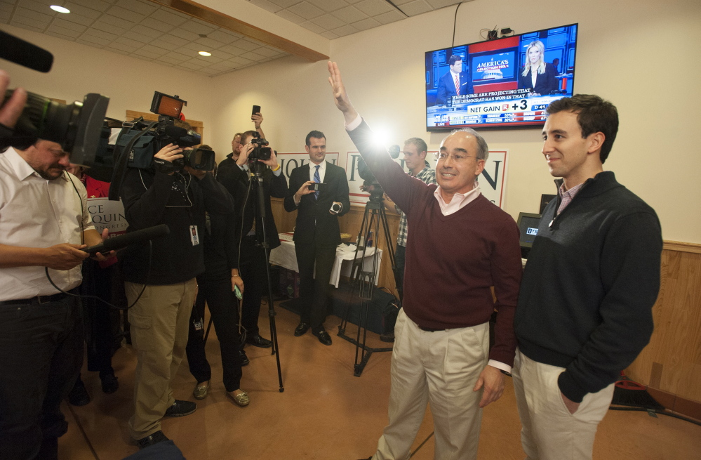 Bruce Poliquin greets his supporters at Dysart's in Bangor, telling them the night will be a long one, he encouraged all to get food and wait for the results on Tuesday evening. At right is Poliquin's son, Sam.