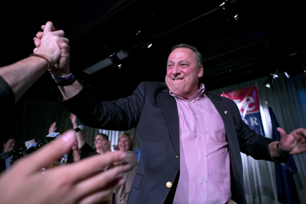 Gov. Paul LePage celebrates the success of his re-election bid at his election night party Tuesday. Once again, he and his Republican colleagues have been given another chance to move his economic ideas forward.