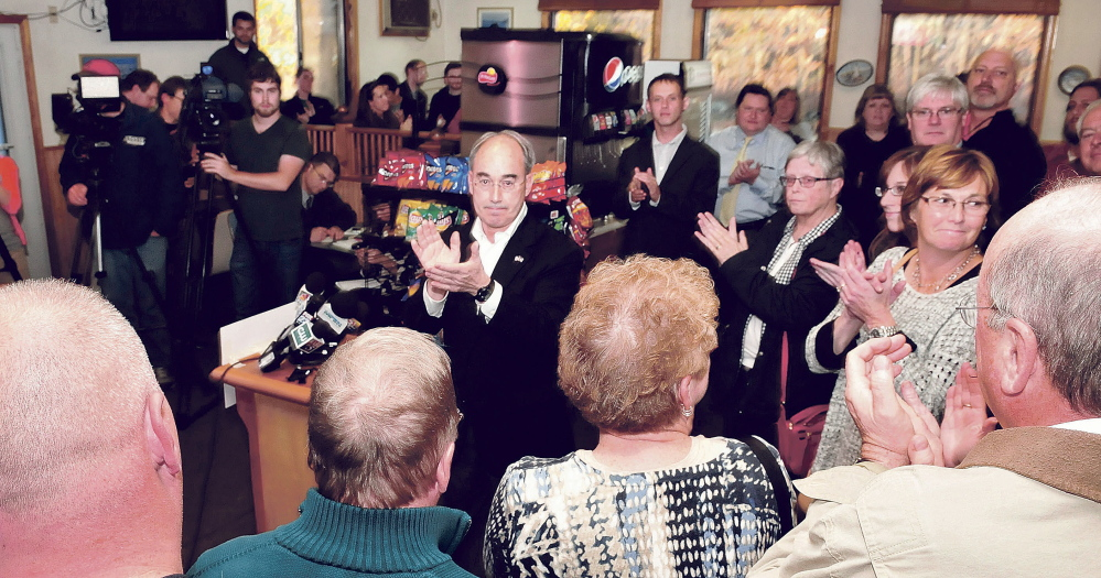 Bruce Poliquin, center, acknowledges supporters during a press conference Wednesday at the Oakland House of Pizza after winning Maine's 2nd District Congressional seat.