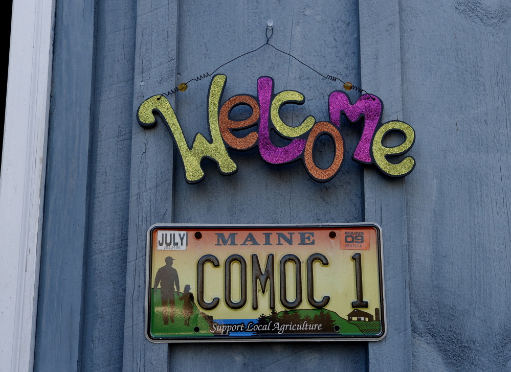 "A ""COMOC"" license plate is the only clue to the new location of Crown O' Maine Organic Cooperative in North Vassalboro. Leah Cook says they haven't gotten around to putting up a sign yet."