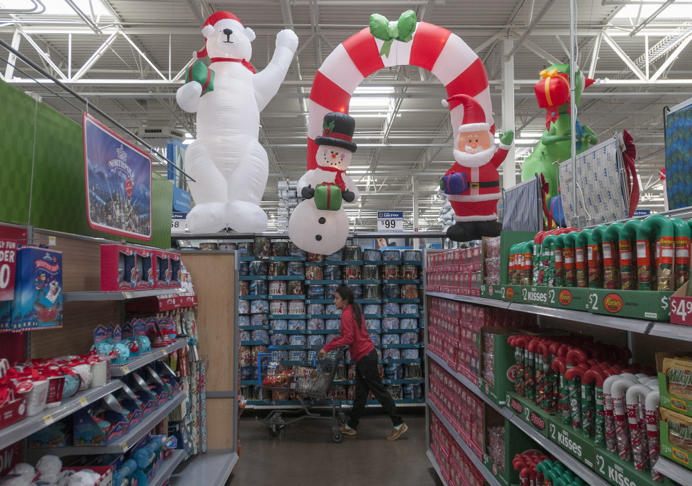 The holiday shopping season is underway, including at this Wal-Mart in Dallas. One retail strategist has forecast that average household spending this season will be $684, down from $735 in 2013. Another, however, said overall spending will be up by 4.1 percent.