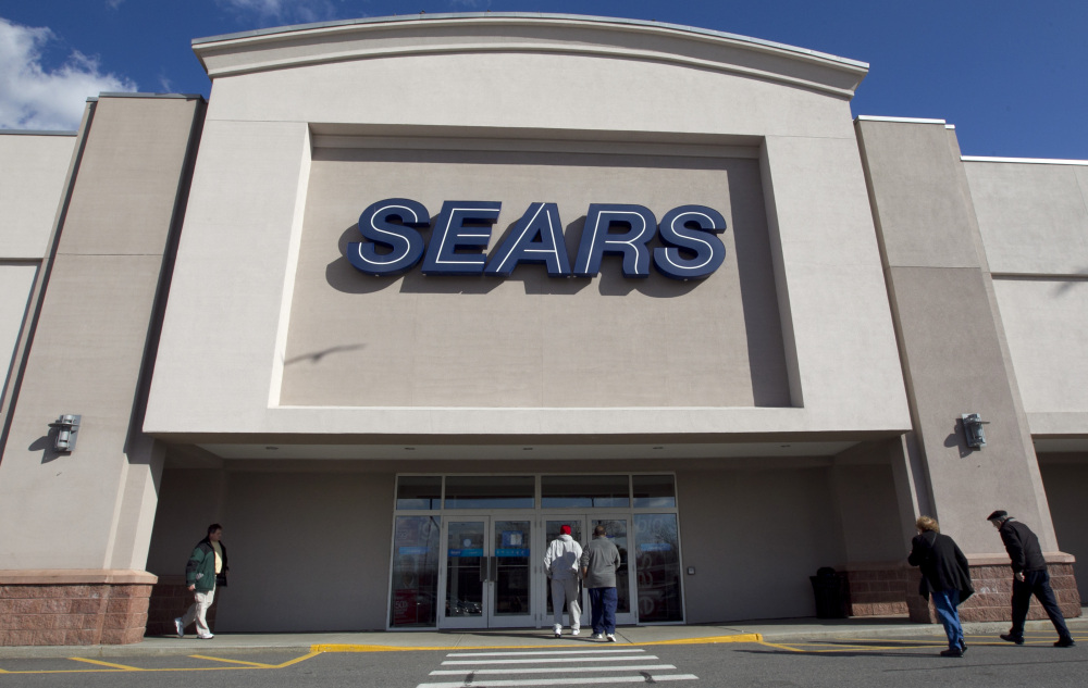 Shoppers enter a Sears department store in Dedham, Mass., in 2012. Sears Holdings stock skyrocketed on Friday.
