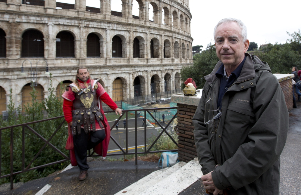 Archaeologist Daniele Manacorda posing in front of Rome's Colosseum on Friday proposes to return the Colosseum's storied arena to its original state.
