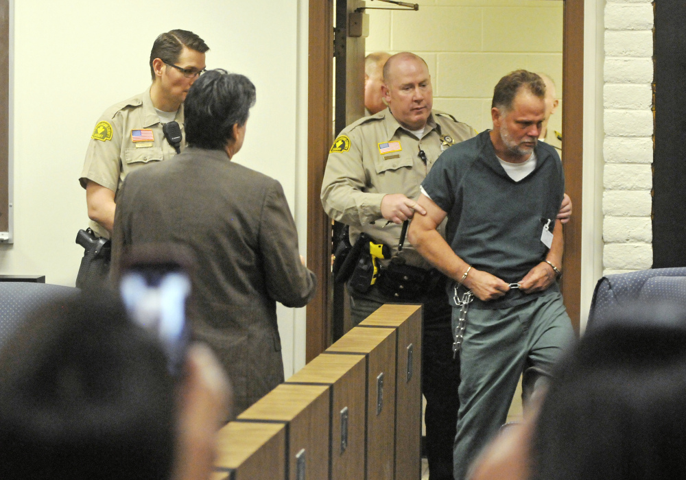 """Charles """"Chase"""" Merritt, 57, is led into court for an arraignment hearing at the the Victorville Courthouse on Friday in Victorville, Calif."""