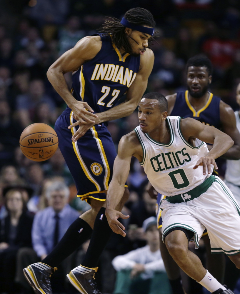Boston Celtics guard Avery Bradley (0) steals the ball from Indiana Pacers forward Chris Copeland (22) during the second quarter in Boston on Friday. The Associated Press