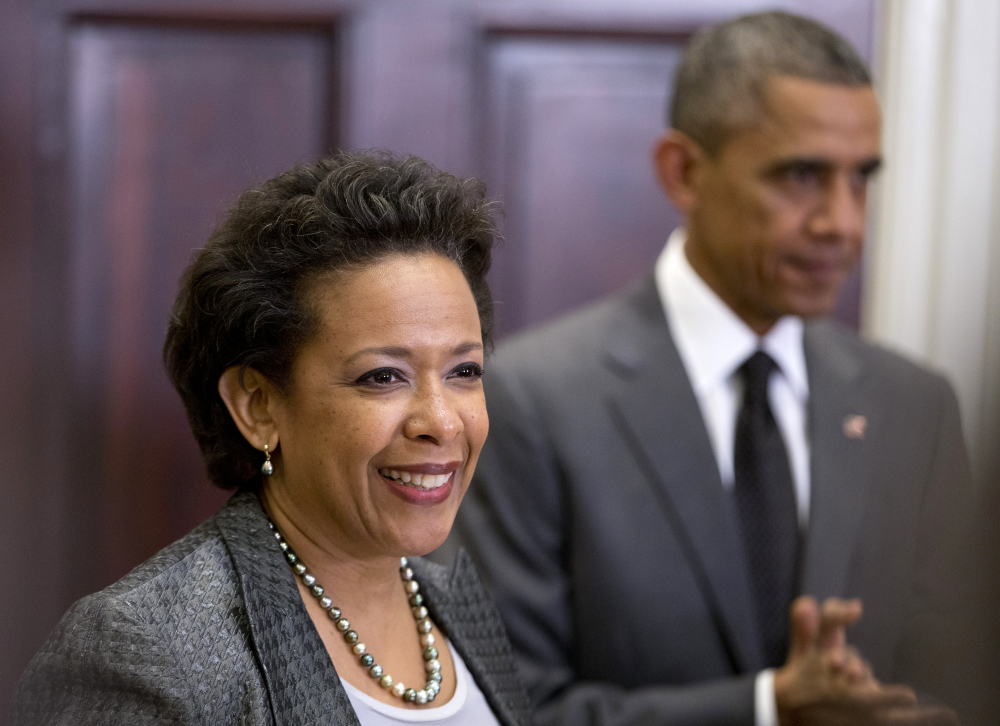 President Barack Obama listens as U.S. Attorney Loretta Lynch speaks in the Roosevelt Room of the White House in Washington on Saturday. The president announced he would nominate Lynch to replace Attorney General Eric Holder.