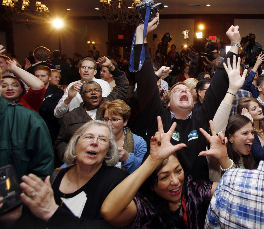 Democratic supporters cheer during Sen. Jeanne Shaheen's victory party in Manchester, N.H., late Tuesday night, but the popular senator's coattails weren't long enough to carry lower-ticket candidates.