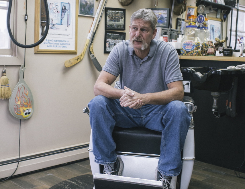 "Ron Miller sits in his barbershop in Greene, a town that voted heavily for Paul LePage. ""With our town, there was no doubt we would vote (for)LePage. ... The way I look at things, being a barber now, and a U.S. Navy diver for 20 years, I'm not politically correct at all. But the one thing about here, is your opinions matter. I like to hear all sides,"" Miller said."