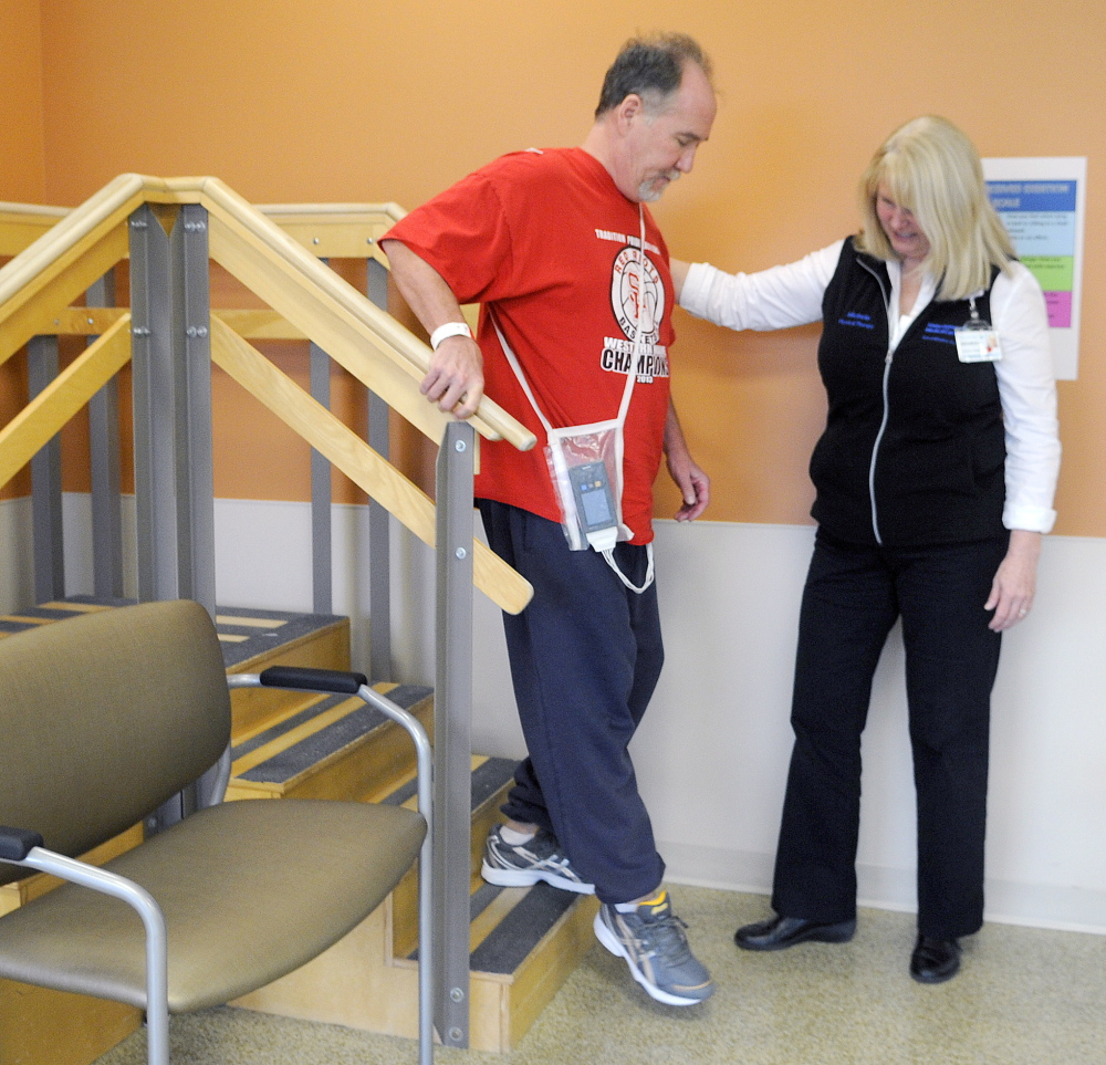 Jim Byrne practices steps with physical therapist Michele Walter in the long-term care and rehabilitation facility at MaineGeneral. The hospital is celebrating its first anniversary.