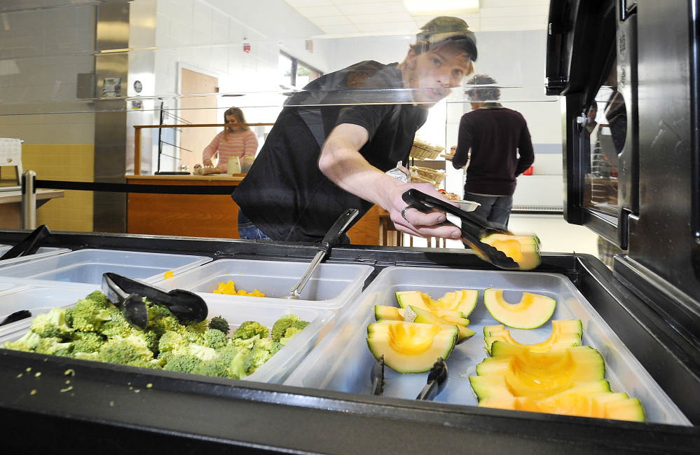 Corey Reddy, a senior, adds fruit to his meal at Kennebunk High School .