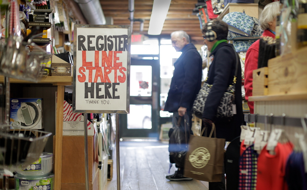 Shoppers browse at LeRoux Kitchen on Commercial Street in Portland on Black Friday 2013.