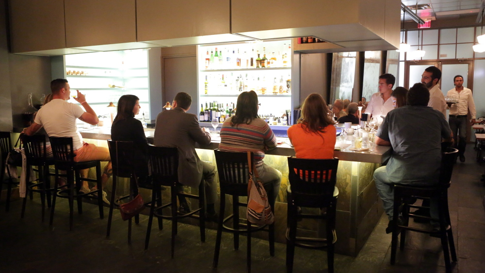 Patrons sit at the bar in Pharmacy, a speakeasy-style restaurant in Orlando.