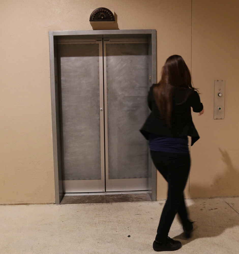 A fake elevator is the entrance to Pharmacy.