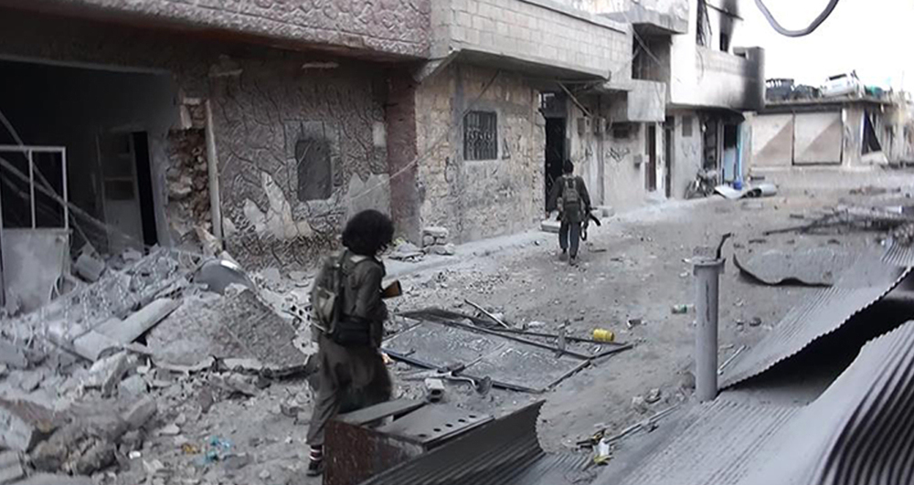 Islamic State extremists patrol Kobani, Syria. Kurdish fighters have made steady advances in the past two weeks, following the arrival of the peshmerga forces in the border town.