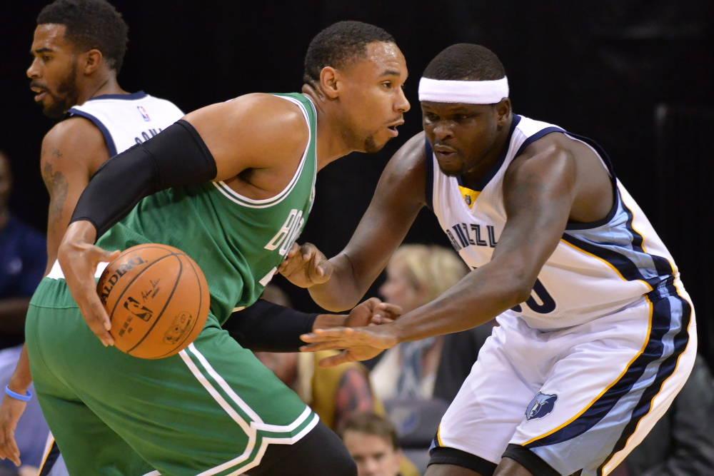 Boston Celtics forward Jared Sullinger drives against Memphis Grizzlies forward Zach Randolph in the first half of Friday night's game in Memphis.
