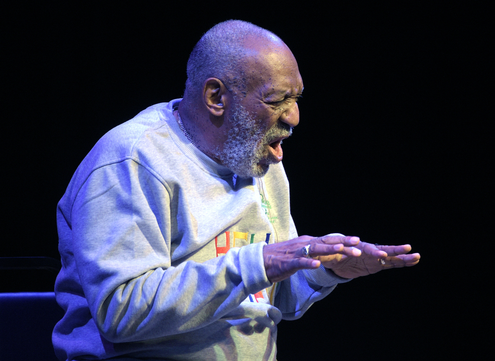 Comedian Bill Cosby performs at the Maxwell C. King Center for the Performing Arts, in Melbourne, Fla., Friday. Performances by Cosby in Nevada, Illinois, Arizona, South Carolina and Washington state have been canceled as more women come forward accusing the entertainer of sexually assaulting them years ago.
