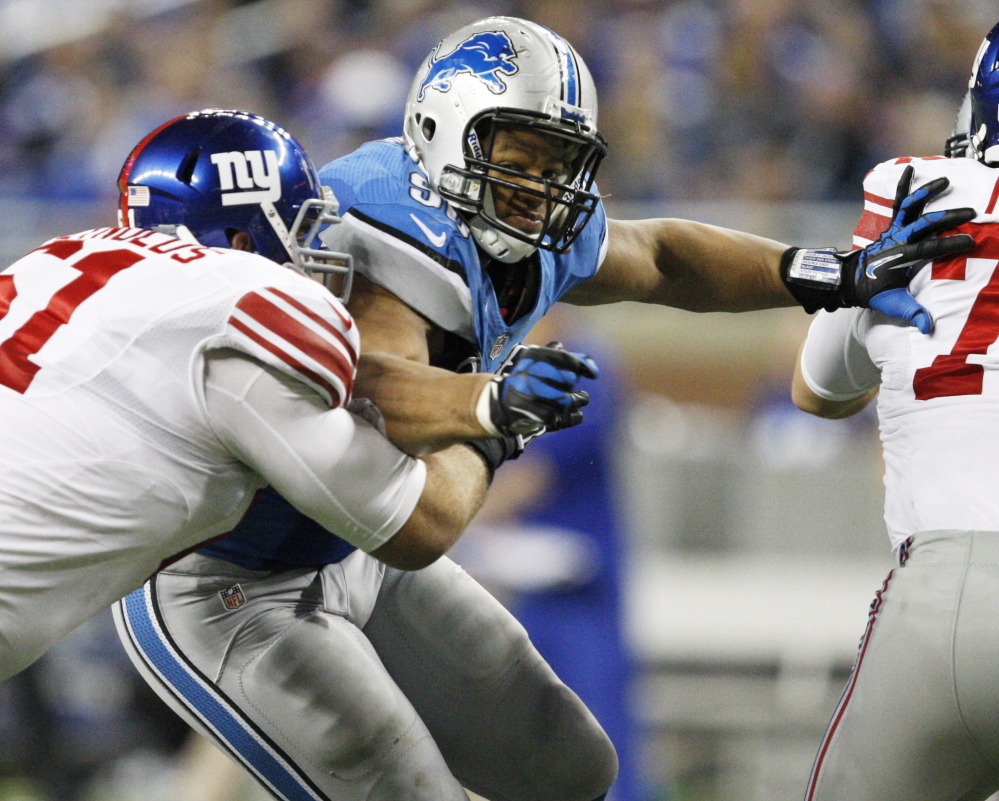 Defensive tackle Ndamukong Suh, center, who will be going after New England's Tom Brady on Sunday, leads a tough Detroit defense that has allowed the fewest yards in the league.