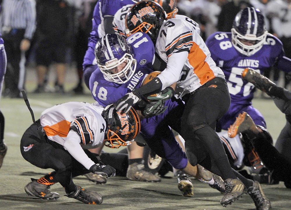 Jackson Howarth of Marshwood plows through the Brunswick line during the Class B state championship game Saturday night at Fitzpatrick Stadium. Marshwood claimed its first state title in 25 years with a 44-18 victory.