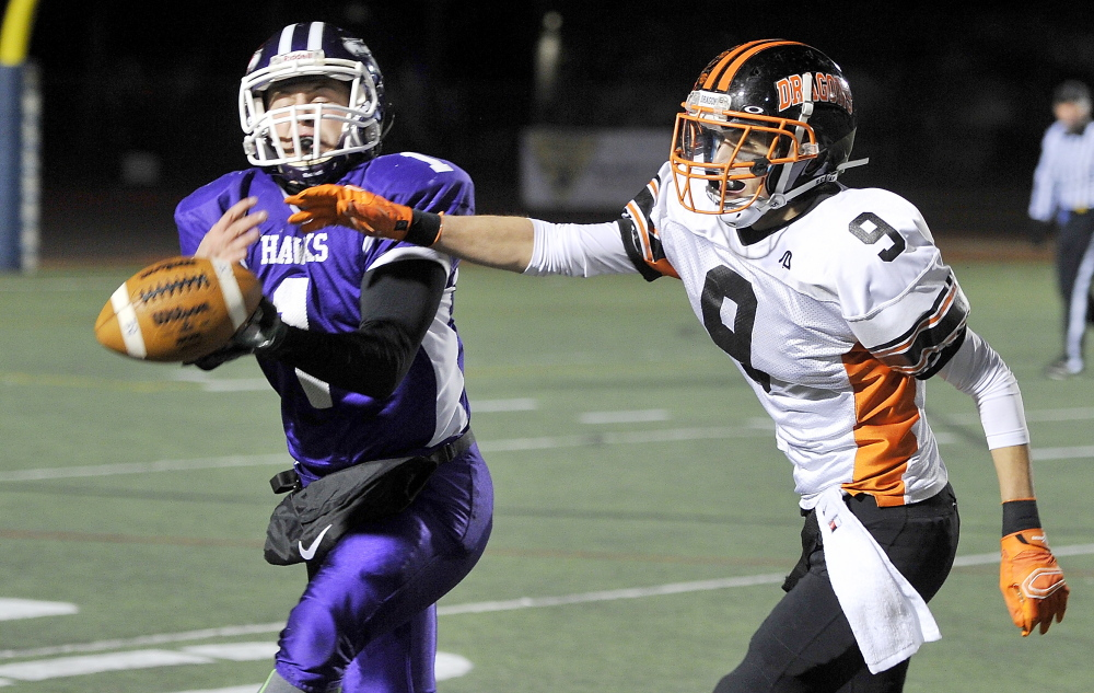 Marshwood's Luc Blanchette couldn't pull in this interception as Brunswick receiver Rick Klatt broke up the play, but Blanchette did just about everything else right Saturday, rushing for more than 200 yards while leading the Hawks to a 44-18 win in the Class B state championship game.