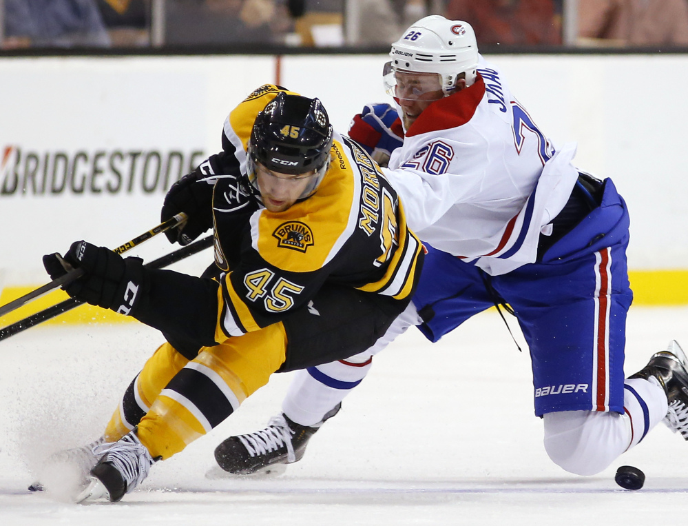 Boston's Joe Morrow and Montreal's Jiri Sekac battle for the puck during the first period of Saturday's game in Boston, won by the Canadiens.