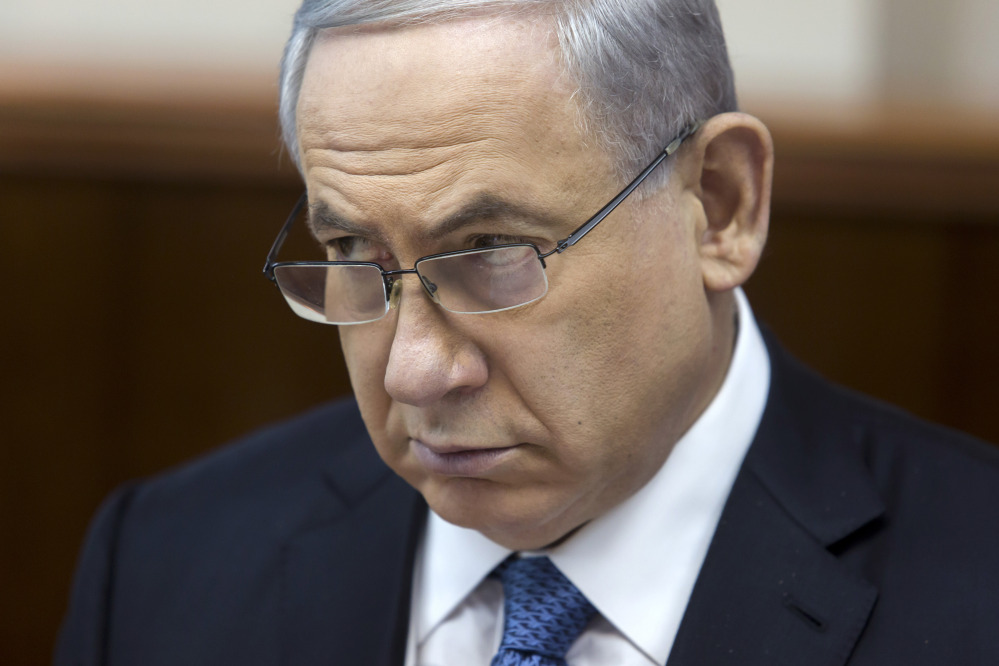 Israeli Prime Minister Benjamin Netanyahu listens during in his Cabinet meeting in his office in Jerusalem on Sunday. At the start of the meeting, Netanyahu called for a bill that would revoke residency rights for Palestinians involved in attacks against Israelis.